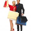 Man and woman with shopping bags — Stock Photo #15786911