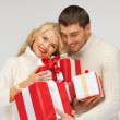 Romantic couple in a sweaters with gift boxes — Stock Photo