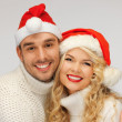 Family couple in sweaters and santa's hats — Stock Photo #15787491