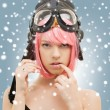 Stock Photo: Pink hair girl in aviator helmet with snow