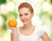 Teenage girl with orange — Stock Photo