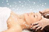 Beautiful woman in massage salon with snow — Stock Photo
