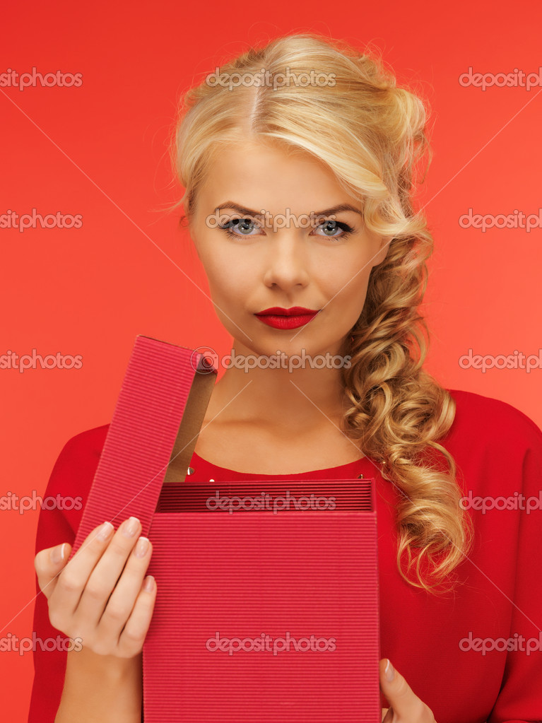 Picture of lovely woman in red dress with opened gift box — Stock Photo #15786737