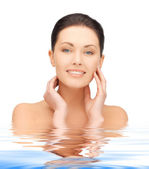 Face and hands of beautiful woman in water — Stock Photo
