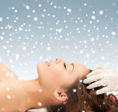 Beautiful woman in massage salon with snow — Stock Photo