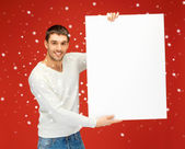 Handsome man with big blank board — Stock fotografie