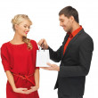 Man and woman with present — Stock Photo #15910011