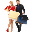 Man and woman with shopping bags — Stock Photo #15912395