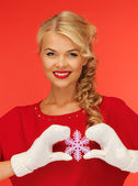 Woman in mittens and red dress with snowflake — Stock Photo