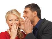 Man and woman spreading gossip — Stock Photo