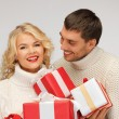 Family couple in a sweaters with gift boxes — Stock Photo #16076867