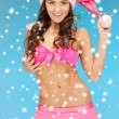 Royalty-Free Stock Photo: Cheerful santa helper girl in lingerie with snow