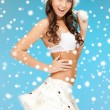Cheerful santa helper girl in lingerie with snow — Stock Photo