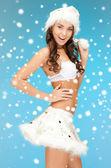 Cheerful santa helper girl in lingerie with snow — Stok fotoğraf
