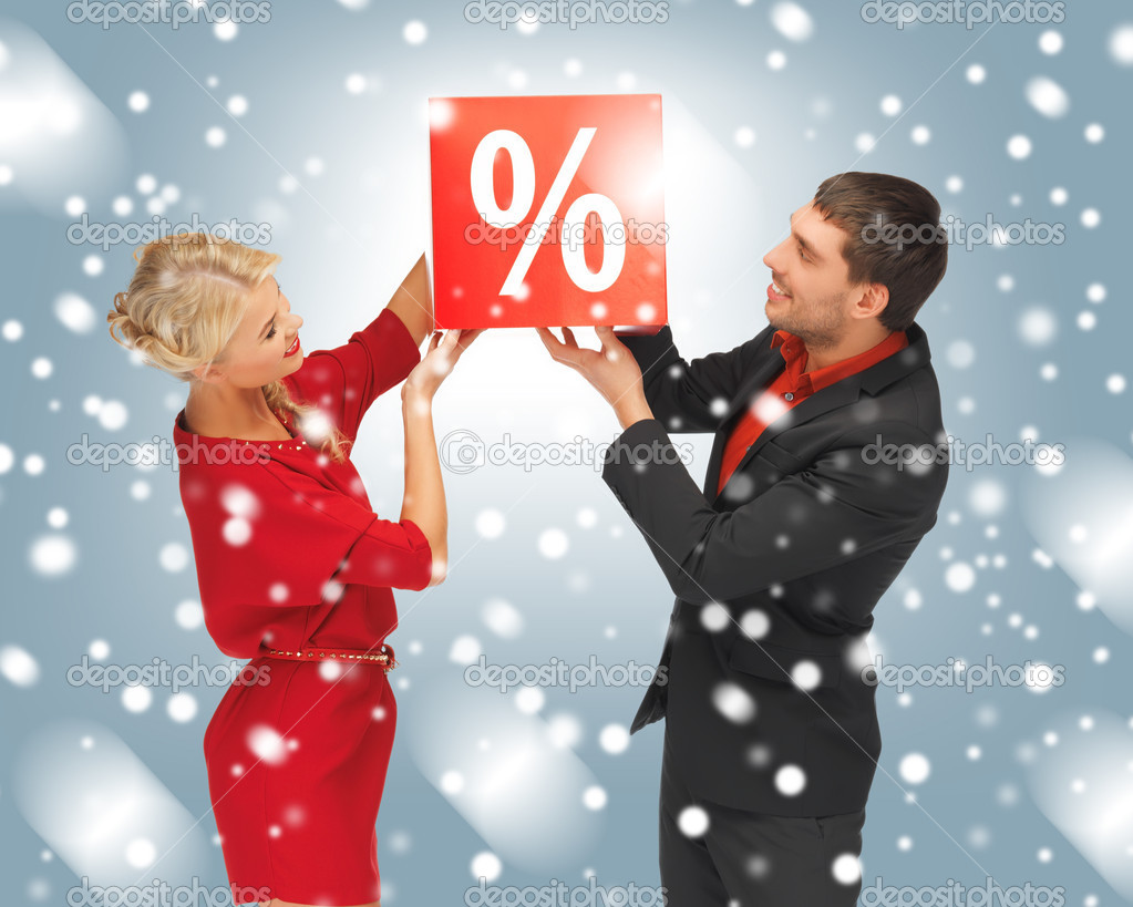 Bright picture of man and woman with percent sign — Stock Photo #16080555