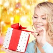 Happy woman with gift box — Stock Photo #16192133