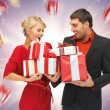 Man and woman with gift boxes — Stock Photo #16192305