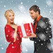 Man and woman with present — Stock Photo #16193263