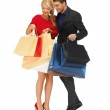 Man and woman with shopping bags — Stock Photo #16381399