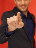 Handsome man in suit pressing virtual button — Stock Photo
