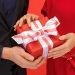 Royalty-Free Stock Photo: Man and woman\'s hands with gift box