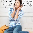 Happy teenage girl in big headphones - Stock Photo
