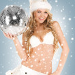 Sexy santa helper with disco ball — Stock fotografie