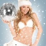 Sexy santa helper with disco ball — Stock Photo