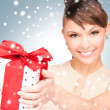 Happy woman with gift box — Stock Photo #16798553