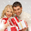 Romantic couple in a sweaters with gift boxes — Stock fotografie