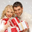Romantic couple in a sweaters with gift boxes — Stok fotoğraf