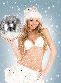 Sexy santa helper with disco ball — Stock Photo
