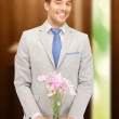 Royalty-Free Stock Photo: Handsome man with flowers in hand