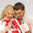 Romantic couple in a sweaters with gift boxes — Stock Photo #16908675
