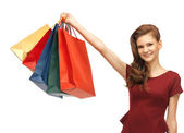 Happy teenage girl with shopping bags — Stok fotoğraf