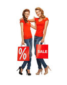 Two teenage girls with shopping bags — Stock Photo