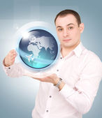 Earth globe on the palms of his hands — Stock Photo