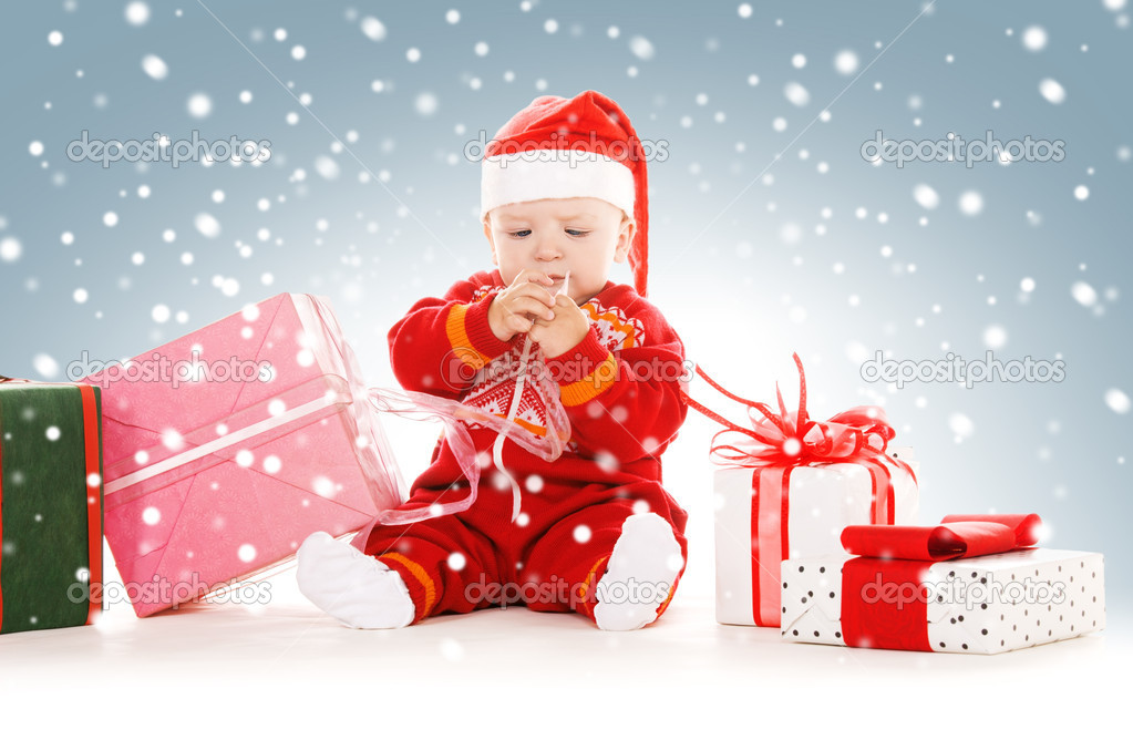 Picture of santa helper baby with christmas gifts — Stock Photo #16908613