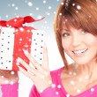 Stock Photo: Happy woman with gift box