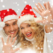 Family couple in sweaters and santa's hats — Stock Photo #16969041