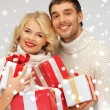 Family couple in a sweaters with gift boxes — Stock Photo #16969107