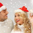 Family couple in sweaters and santa's hats — Stock Photo #16969121