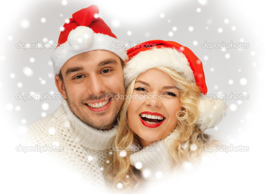 Picture of family couple in sweaters and santa's hats — Stock Photo #16969141