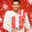 Man holding many gift boxes — Stock Photo