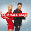 Man and woman with sale sign — Foto Stock