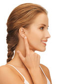 Woman pointing to ear — Stock Photo