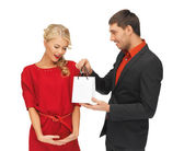 Man and woman with present — Stock Photo