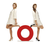Two teenage girls with o letter — Stock Photo