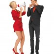 Beautiful couple with megaphone — Stock Photo #17165565