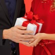 Man and woman's hands with gift box — Stock Photo #17165655